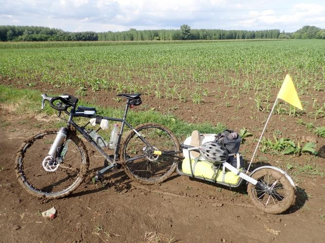 Extra sticky Hungarian mud. Fortunately a short stretch but with the wheels locked the only way forward was carrying...